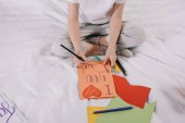 "Постер, картина, фотообои ""partial view of kid drawing fathers day greeting card while sitting on bed"""