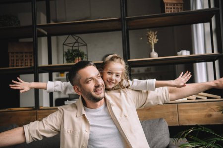 Photo for Happy father with adorable daughter having fun together at home - Royalty Free Image