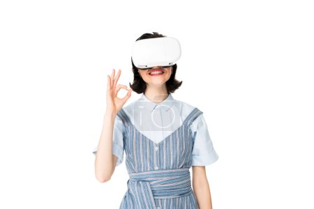 Photo for Girl with VR headset showing Ok sign at camera isolated on white - Royalty Free Image