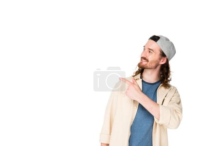 handsome young man pointing with finger isolated on white