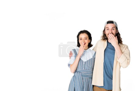 Photo for Surprised girl and young man standing close to each other isolated on white - Royalty Free Image