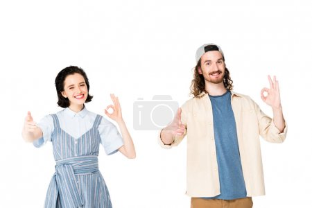 Photo for Two people pointing with fingers at camera and showing OK signs isolated on white - Royalty Free Image