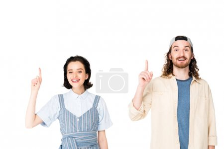 Photo pour Young man and girl showing an idea and smile isolated on white - image libre de droit