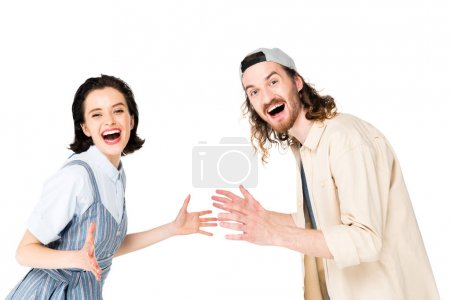 Foto de Young man and girl smiling at camera with joy isolated on white - Imagen libre de derechos
