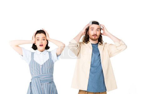 Foto de Shocked two people holding heads with hands isolated on white - Imagen libre de derechos