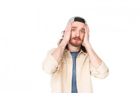 Photo pour Jeune homme choqué retenant la tête avec des mains d'isolement sur le blanc - image libre de droit