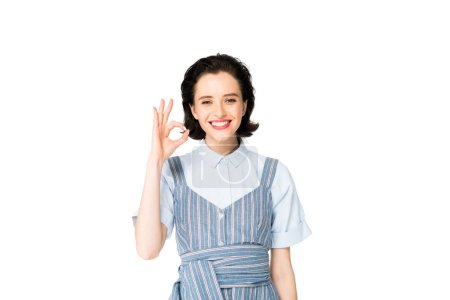 Photo for Beautiful girl smiling at camera and showing OK sign isolated on white - Royalty Free Image