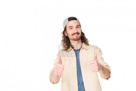 Photo for Handsome young man showing thumbs up at camera isolated on white - Royalty Free Image