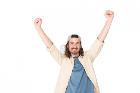 Photo for Excited young man raising hands in air isolated on white - Royalty Free Image
