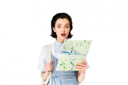 Photo for Shocked girl holding map and looking at camera isolated on white - Royalty Free Image