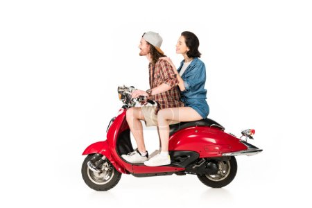 Photo for Side view of girl and young man looking forward, smiling and sitting on red scooter isolated on white - Royalty Free Image