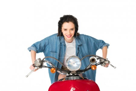 Photo for Front view of girl ready to ride sitting on red scooter isolated on white - Royalty Free Image