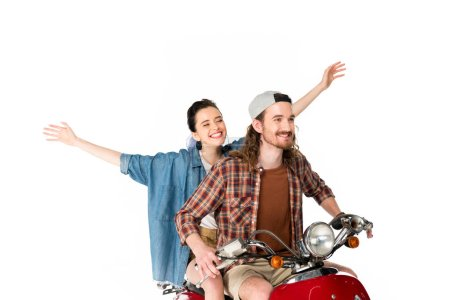 Photo for Couple of young tourists riding on red scooter holding hands in air isolated on white - Royalty Free Image