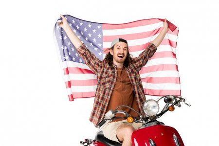 Photo for Excited young man sitting on red scooter and holding American flag on air isolated on white - Royalty Free Image