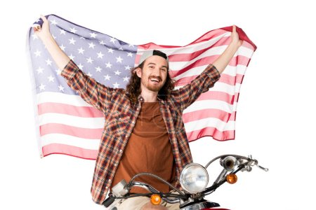 Photo pour Young man sitting on red scooter, smiling and holding American flag on air isolated on white - image libre de droit