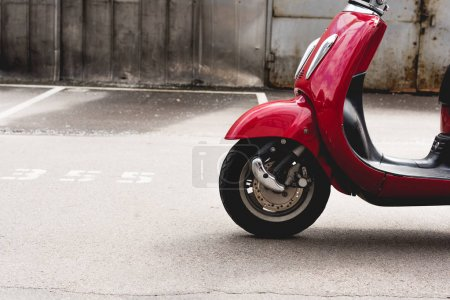 Foto de New red scooter standing outside in sunlight place - Imagen libre de derechos