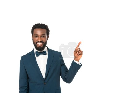 Photo for Happy african american bridegroom pointing with finger isolated on white - Royalty Free Image