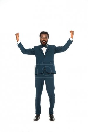 Photo for Happy african american bridegroom gesturing while celebrating isolated on white - Royalty Free Image
