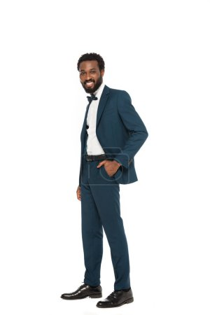 Photo for Happy african american bridegroom standing with hand in pocket isolated on white - Royalty Free Image