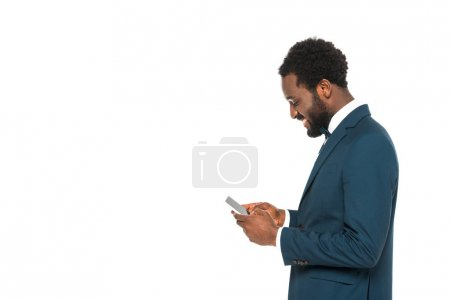 Photo for Cheerful african american bridegroom using smartphone isolated on white - Royalty Free Image