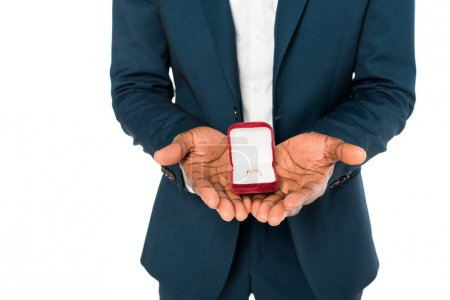 Photo for Cropped view of african american bridegroom holding box with wedding ring isolated on white - Royalty Free Image