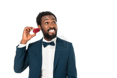 Photo for Cheerful african american man holding red box isolated on white - Royalty Free Image