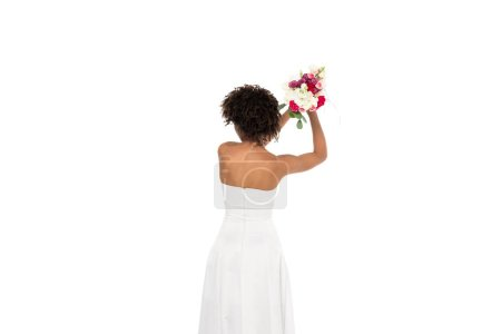 Photo for Back view of african american bride throwing bouquet isolated on white - Royalty Free Image