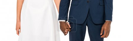Photo for Panoramic shot of african american bride and bridegroom holding hands while standing isolated on white - Royalty Free Image