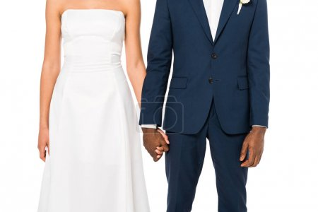 Photo for Cropped view of african american bride and bridegroom holding hands while standing isolated on white - Royalty Free Image