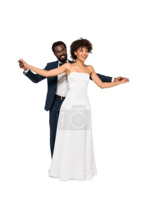 Photo for Happy african american bridegroom and bride standing with outstretched hands isolated on white - Royalty Free Image