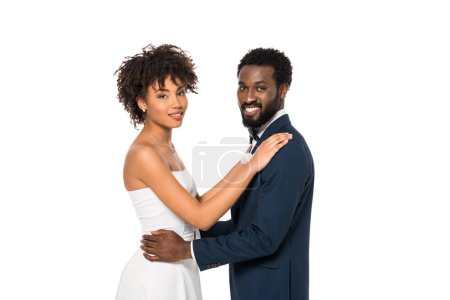 Photo for Smiling african american bride and bridegroom hugging isolated on white - Royalty Free Image