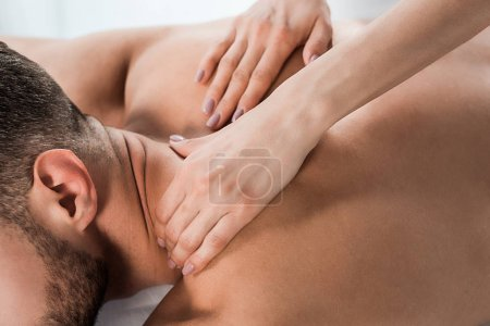 Photo for Close up of masseur doing massage to bearded man in spa center - Royalty Free Image