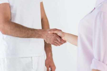 Photo for Cropped view of man and woman shaking hands isolated on white - Royalty Free Image