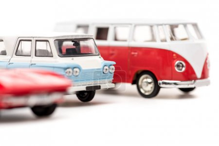 Photo pour Selective focus of toy cars and bus on white - image libre de droit