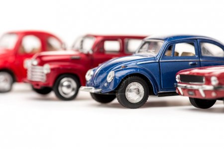 Selective focus of colorful toy cars on white...