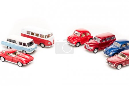 Photo for Colorful toy cars and bus on white surface - Royalty Free Image