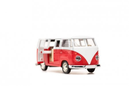 Photo for Selective focus of red toy bus on white with copy space - Royalty Free Image
