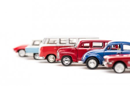 Selective focus of colorful toy cars and bus on wh...