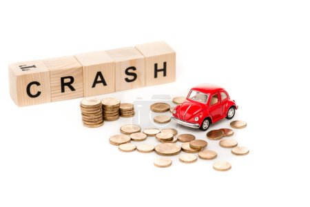 Photo for Red toy car, wooden blocks with letters and golden coins on white - Royalty Free Image
