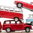 Colorful toy cars and toy bus isolated on white...