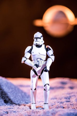 Photo for KYIV, UKRAINE - MAY 25, 2019: white imperial stormtrooper on cosmic planet on dark background - Royalty Free Image