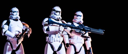 Photo for KYIV, UKRAINE - MAY 25, 2019: panoramic shot of white imperial stormtroopers with guns isolated on black - Royalty Free Image