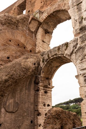 ROME, ITALY - JUNE 28, 2019: textured ruins of ancient building
