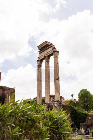 Photo for ROME, ITALY - JUNE 28, 2019: selective focus of tourists near temple of Castor and Pollux - Royalty Free Image