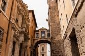"Постер, картина, фотообои ""old buildings with bas-reliefs under grey sky in rome, italy"""