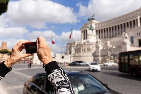 Photo for ROME, ITALY - JUNE 28, 2019: cropped view of senior woman taking picture of museum in sunny day - Royalty Free Image