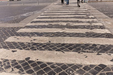 Photo for Cropped view of people at crosswalk in rome, italy - Royalty Free Image