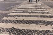 "Постер, картина, фотообои ""cropped view of people at crosswalk in rome, italy"""