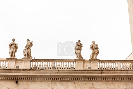 Photo for ROME, ITALY - JUNE 28, 2019: old building with roman statues under grey sky - Royalty Free Image