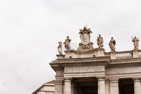 Photo for ROME, ITALY - JUNE 28, 2019: ancient building with roman sculptures under overcast sky - Royalty Free Image